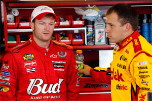 Dale Earnhardt Jr. (left) talks with Ryan Newman after practice at Watkins Glen International. (Photo Credit: John Harrelson/Getty Images for NASCAR)