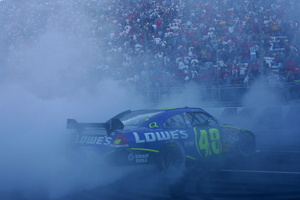 Jimmie Johnson celebrates after winning at Martinsville Speedway. (Photo Credit: Todd Warshaw/Getty Images for NASCAR)