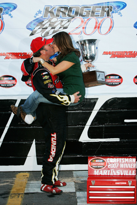 Mike Skinner, driver of the #5 Toyota Tundra Toyota, kisses his wife, Angela after winning the NASCAR Craftsman Truck Series Kroger 200 at Martinsville Speedway on October 20, 2007 in Martinsville, Virginia. (Photo by Jason Smith/Getty Images for NASCAR)