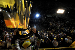 Jimmie Johnson raises the NASCAR NEXTEL Cup championship trophy for the second consecutive season at Homestead-Miami Speedway. (Photo Credit: Rusty Jarrett/Getty Images for NASCAR)