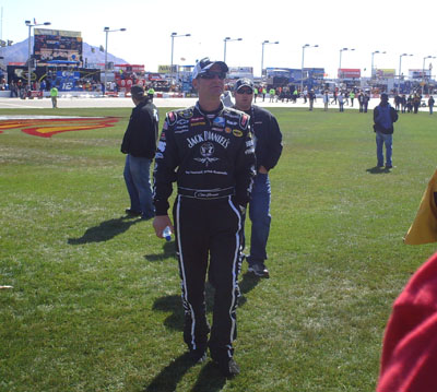 Clint Bowyer watches The Blue Man Group perform before the start of the UAW-Dodge 400 in Las Vegas (Photo Credit: The Fast and the Fabulous/Valli Hilaire)