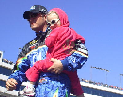 J.J. Yeley and his adorable daughter Faith exit the stage during driver introductions at the UAW-Dodge 400 in Las Vegas (Photo Credit: The Fast and the Fabulous/Valli Hilaire)