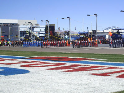 Pit crews line up for the singing of the national anthem at Las Vegas Motor Speedway (photo credit: The Fast and the Fabulous/Valli Hilaire)