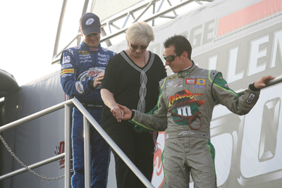 Kurt (left) and Kyle (right) help their mother Gaye (center) off of the stage before the Dodge Challenger 500 at Darlington Raceway (Photo Credit: Jerry Markland/Getty Images for NASCAR)