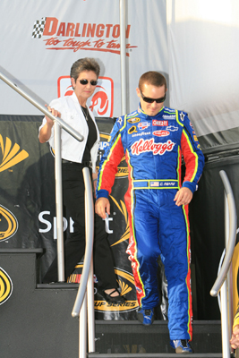 Carol Mears follows her son Casey off of the stage before the Dodge Challenger 500 at Darlington Raceway (Photo Credit: Jerry Markland/Getty Images for NASCAR)