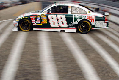 Driving a retro Mountain Dew paint scheme at NASCAR's second oldest track, Dale Earnhardt Jr. drives through the garage area at Darlington Raceway (Photo Credit: Chris Graythen / Getty Images)