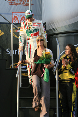 Dale Earnhardt Jr. follows his mother, Brenda Jackson, off of the stage before the Dodge Challenger 500 at Darlington Raceway (Photo Credit: Jerry Markland/Getty Images for NASCAR)