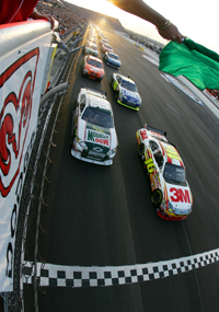 Polesitter Greg Biffle (No. 16) and Dale Earnhardt Jr. lead the field to the green flag of the Dodge Challenger 500 NASCAR Sprint Cup Series race at Darlington Raceway (Photo Credit: Chris Trotman/Getty Images for NASCAR)