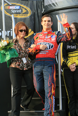 Carol Bickford and her son, Jeff Gordon, waves at the crowd at Darlington Raceway, where Gordon has won seven NASCAR Sprint Cup Series races (Photo Credit: Jerry Markland/Getty Images for NASCAR)
