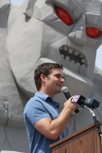 NASCAR Sprint Cup Series driver Jeff Gordon addresses an assembled crowd of dignitaries and race fans at Dover International Speedway on Wednesday as part of the Monster Monument dedication ceremony (Photo Credit: Dover Motorsports)