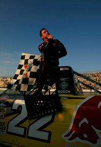 Scott Speed celebrates winning the AAA Insurance 200 at Dover International Speedway, only his sixth NASCAR Craftsman Truck Series race (Photo Credit: Nick Laham/Getty Images)