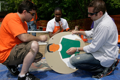 Tony Stewart, NASCAR Sprint Cup Series driver of the #20 Home Depot Racing car & two-time Series Champion and Greg Biffle, NASCAR Sprint Cup Series driver of the #16 3M Racing car help build a build a racing-themed playground in just one day at Elon Homes for Children (Photo Credit: CIA for KaBOOM)