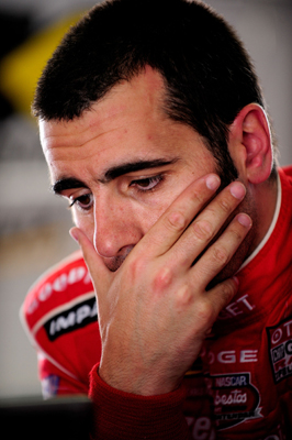 Dario Franchitti reviews data during NASCAR Sprint Cup Series testing at Pocono Raceway. (Photo Credit: Rusty Jarrett/Getty Images for NASCAR)