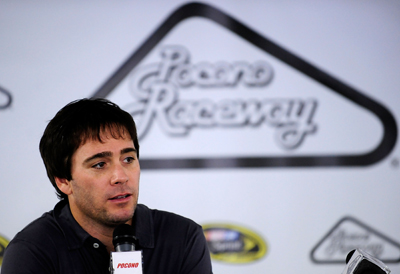 Jimmie Johnson talks with the media during NASCAR Sprint Cup Series testing at Pocono Raceway. (Photo Credit: Rusty Jarrett/Getty Images for NASCAR)