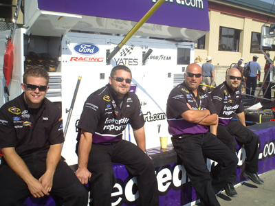 Crew members from the No. 38 FreeCreditReport.com Ford Fusion team