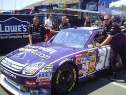 The No. 38 FreeCreditReport.com Ford Fusion gets pushed through inspection at Infineon Raceway (photo credit: The Fast and the Fabulous)