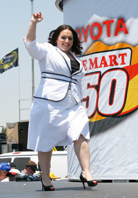 Actress Nikki Blonsky waves to the crowd after singing the National Anthem before the NASCAR Sprint Cup Series Toyota/Save Mart 350 at the Infineon Raceway on June 22, 2008 in Sonoma, California. (Photo by Geoff Burke/Getty Images for NASCAR)