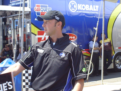 Chad Knaus walks the No. 48 Lowe's Chevrolet through inspection at Infineon Raceway