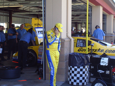 Sam Hornish Jr. chatting on his cell phone during a testing session at Infineon Raceway (Photo Credit: The Fast and the Fabulous)