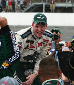 Dale Earnhardt Jr. celebrates winning the LifeLock 400 at Michigan International Speedway. The win ended a 76-race winless streak for Earnhardt. (Photo Credit: Jonathan Daniel/Getty Images)