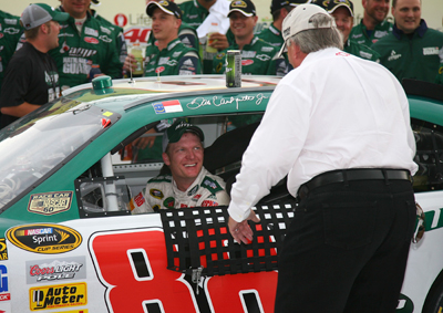 Team owner Rick Hendrick congratulates Dale Earnhardt Jr. after he won the LifeLock 400 at Michigan International Speedway, ending a 76-race winless streak. (Photo Credit: Jerry Markland/Getty Images for NASCAR)