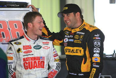 Dale Earnhardt Jr. and Elliott Sadler share a laugh in the garage during Friday's practice at Pocono Raceway (Photo Credit: Jerry Markland/Getty Images for NASCAR)