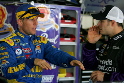 Fellow Ford drivers, Jamie McMurray and David Gilliland, talk about their cars during a break in Saturday's NASCAR Sprint Cup Series practice at Pocono Raceway (Photo Credit: Todd Warshaw/Getty Images)