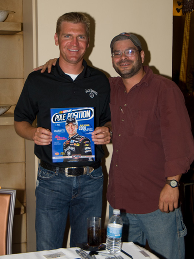 NASCAR Sprint Cup driver Clint Bowyer poses with fan, Al Brown, holding a copy of Pole Position magazine