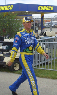 Clint Bowyer walks to the Dollar General 300 drivers and crew chiefs meeting at Chicagoland Speedway on Friday, July 11, 2008 (photo credit: The Fast and the Fabulous