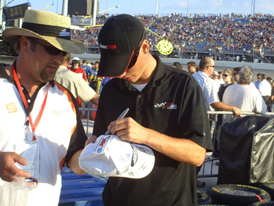 Joey Logano signs his autograph for fans on pit road before the start of the Dollar General 300 at Chicagoland Speedway on Friday, July 11, 2008 (photo credit: The Fast and the Fabulous)