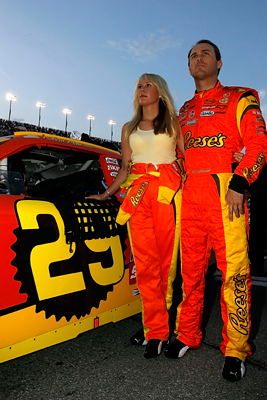 Kevin Harvick (R), driver of the #29 Reese's Chevrolet, stands with wife, DeLana (L), prior to the NASCAR Sprint Cup Series Coke Zero 400 at Daytona International Speedway on July 5, 2008 in Daytona Beach, Florida. (Photo by Jason Smith/Getty Images for NASCAR)