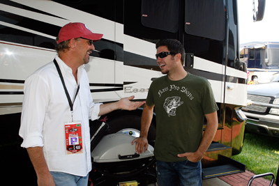 Martin Truex Jr. chats with Kevin Costner, who performed a pre-race concert with his band Modern West. (Photo Credit: Geoff Burke/Getty Images for NASCAR)