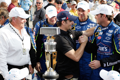 Hendrick Motorsports teammate Jeff Gordon congratulates Jimmie Johnson on his Allstate 400 at the Brickyard victory. (Photo Credit: John Harrelson/Getty Images for NASCAR)