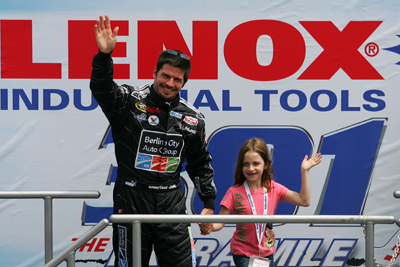 Polesitter Patrick Carpentier and his daughter Anais meet the crowd during driver introductions before the Lenox Industrial Tools 300 at New Hampshire Motor Speedway (Photo Credit: Todd Warshaw/Getty Images for NASCAR)