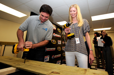 On Friday in the New Hampshire Motor Speedway media center, Jimmie and Chandra Johnson turn the first screws in a project for the Jimmie Johnson Foundation that will provide a home to a family in need. Johnson was second-fastest in Friday's NASCAR Sprint Cup Series practice. (Photo Credit: Rusty Jarrett/Getty Images for NASCAR)