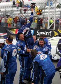 The No. 2 pit crew hoists their driver, Kurt Busch, after he was declared winner of the Lenox Industrial Tools 300 at New Hampshire Motor Speedway (Photo Credit: Jim McIsaac/Getty Images)