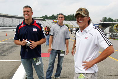 Adam Cristman, Brad Knighton, and Wells Thompson of Major League Soccer's New England Revolution walk the grid prior to the start of qualifying for the NASCAR Sprint Cup Series LENOX Industrial Tools 301 at New Hampshire Motor Speedway on June 27, 2008 in Loudon, New Hampshire. (Photo Credit: Jim McIsaac/Getty Images)
