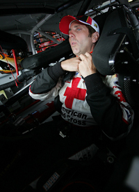 Biffle straps himself into the #16 Ford Fusion to prepare for the start of the Aaron's 499 in Talladega. (Photo courtesy American Red Cross/Red Cross Racing)
