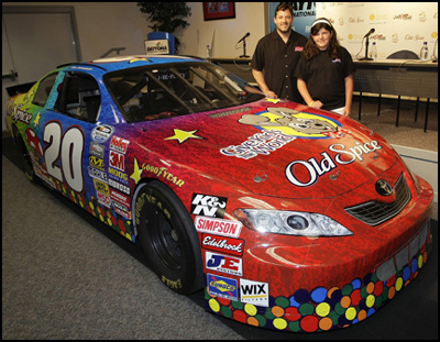 Tony Stewart with Give Kids The World Design Tony's Old Spice car contest winner Emily Marsala