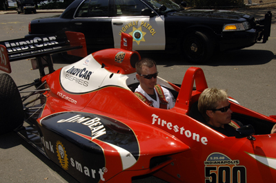 Oakland A's pitcher Brad Ziegler gets a ride to his game on Wednesday from former IndyCar driver Davey Hamilton in a two-seat IndyCar (photo credit: Chucke Walkden)
