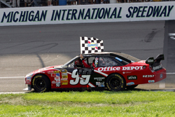 Carl Edwards, driver of the No. 99 Office Depot Ford, celebrates after winning Sunday's NASCAR Sprint Cup Series 3M Performance 400 Presented by Bondo at Michigan International Speedway. (Photo Credit: John Harrelson/Getty Images for NASCAR)