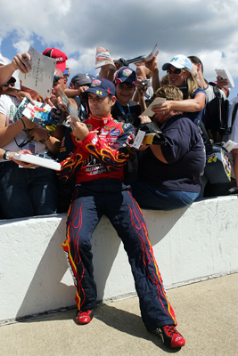 Fans crowd around Jeff Gordon, driver of the No. 24 Dupont Chevrolet, during qualifying Friday at Michigan International Speedway (Photo Credit: Ronald Martinez/Getty Images)