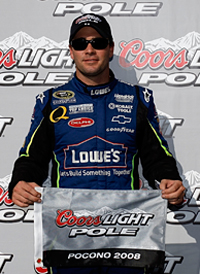 Jimmie Johnson, driver of the No. 48 Lowe's Chevrolet, celebrates winning the pole for Sunday's Sunoco Red Cross Pennsylvania 500 NASCAR Sprint Cup Series race with a speed of 168.215 mph. (Photo Credit: Jason Smith/Getty Images for NASCAR)