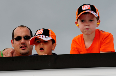 These fans of the No. 20 Home Depot were probably pretty happy with driver Tony Stewart's second-place finish in Sunday's NASCAR Sprint Cup Series Sunoco Red Cross Pennsylvania 500 at Pocono Raceway. (Photo Credit: Rusty Jarrett/Getty Images for NASCAR)