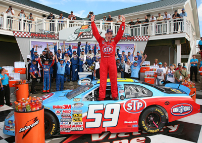 Marcos Ambros driver of the #59 STP Ford celebrates winning the NASCAR Nationwide Series Zippo 200 at the Watkins Glen International on August 9, 2008 in Watkins Glen, NY. (Photo by Jerry Markland/Getty Images for NASCAR)
