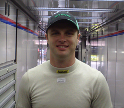Travis Kvapil inside the No. 28 Hitachi