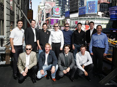 All 12 drivers in the Chase for the NASCAR Sprint Cup (back row l-r: Jimmie Johnson, Kyle Busch, Tony Stewart, Jeff Burton, Dale Earnhardt Jr., Denny Hamlin, Carl Edwards and Greg Biffle; front row l-r: Kevin Harvick, Clint Bowyer, Jeff Gordon and Matt Kenseth) pose on the marquee of the New York City Hard Rock Cafe in Times Square during Chase Media Day. (Photo Credit: Mike Stobe/Getty Images for NASCAR)