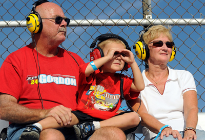 <br /> Fans watch the action from the stands during the NASCAR Nationwide Series Camping World RV Sales 200 on Saturday at Dover International Speedway. (Photo Credit: Grant Halverson/Getty Images for NASCAR)