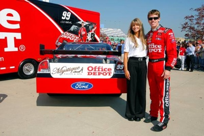 (September 26, 2008): NASCAR star and current Sprint Cup Series point leader Carl Edwards and Julie Catalano of Boise, Idaho, stand next to her company's logo on the No. 99 Office Depot Ford