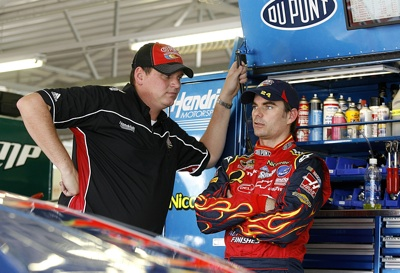Steve Letarte, crew chief for the No. 24 DuPont Chevrolet, talks with his driver, Jeff Gordon, during practice Friday at Kansas Speedway. Gordon, who qualified 13th, was able to practice and qualify despite not feeling well all day. (Photo Credit: Jason Smith/Getty Images for NASCAR)